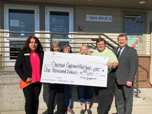 Staff from the Oakdale branch of TruStone Financial presented a check for $1,000 to CCEFS staff at the organization's food shelf in Oakdale.