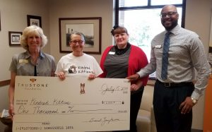 Staff from Kindred Kitties accepted the $1,000 donation at TruStone Financial's Northside Kenosha branch.